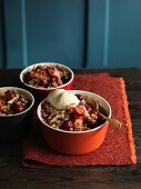 Fruit and walnut crumble with a scoop of vanilla ice cream