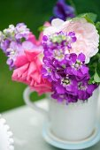 Bouquet of summer flowers decorating buffet table (close-up)