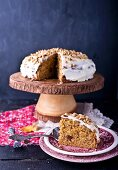 Carrot cake with pine nuts, sliced