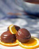Orange confectionery on orange slices