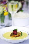 Creamy soup with fried zander and beetroot dumplings