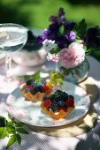 Mini lemon tartlets with mixed summer berries