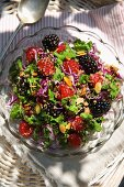 A light quinoa salad with red cabbage and berries
