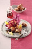 Marinated red cabbage salad with dates wrapped in pancetta and hazelnuts