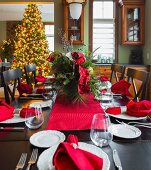 Christmas table and Christmas tree in dining room
