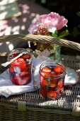 Glasses of berry compote on top of a picnic basket