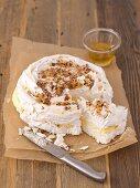 Meringue cake with vanilla cream, sliced