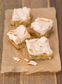 Four slices of apple cake with meringue