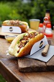 Poultry sausage hot dog with onions, sultanas, lettuce and mayonnaise