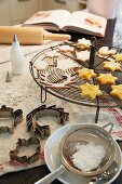 Christmas biscuits being dusted with icing sugar