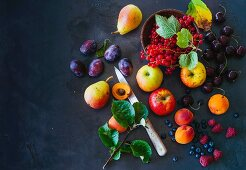 An arrangement of fruit featuring berries and leaves