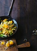 Oriental scrambled eggs with an orange and bean sprout salad
