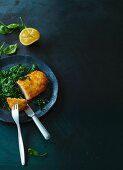 Turkey escalope with a coconut crust on a bed of spinach