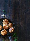 Venison burgers in a pan