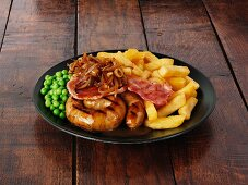 Cumberland sausage with bacon, onions, gravy and chips