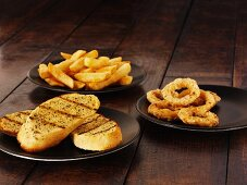 Garlic bread, onion rings and chips
