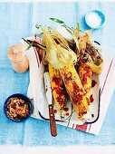 Barbecued corn cobs with sun-dried tomato