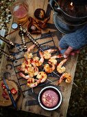Grilled prawn and coconut skewers