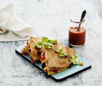 Egg quesadillas with corn, coriander and tomato sauce