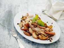 Omelette with apple slices and rye breadcrumbs
