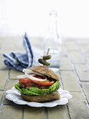 A vegetable burger on a wholemeal roll