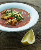 Pork casserole with tomatoes, mushrooms and parsley