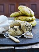 Bread rolls with black fennel and flat breads with turmeric
