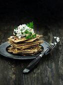 A stack of wholemeal crispbread and crabmeat salad with apple pieces