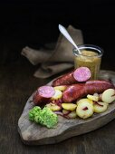 Rustic bratwurst with potato salad and mustard