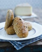 Hearty bread rolls with raisins and sesame seeds
