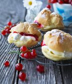 Profiteroles filled with cream and redcurrants