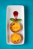 Pastel de nata (puff pasty filled with vanilla cream, Portugal)