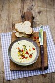 An egg and mustard dip with pointed peppers