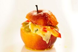 A baked apple with blue cheese