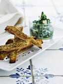 Homemade herb and cheese crackers with spinach salsa