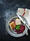 Crispy roast pork with red cabbage
