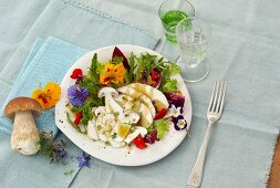 Porcini mushroom carpaccio with edible flowers