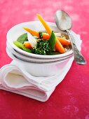 Clear broth with colourful vegetables