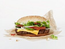 A cheeseburger on a piece of paper
