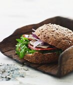 A wholemeal roll with rocket and smoked, rolled fillet of ham