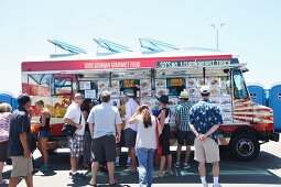 People at food truck festival in California, USA