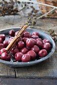 Preserved cherries with cinnamon sticks
