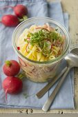 Pasta salad with radishes and strips of Lyon ham