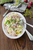 Pasta salad with radishes, Lyon ham and cress
