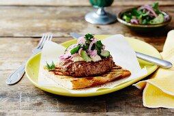 Lamb burger with hummus on Turkish unleavened bread