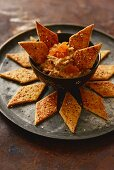 Za'atar cracker with walnuts and sheep's cheese served with date cream (Arabia)