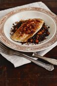 Fish fillet with cinnamon puy lentils and saffron shallots (Arabia)