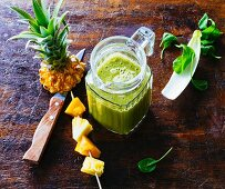 Mango and pineapple smoothie with passion fruit, batavia lettuce, spinach and chicory