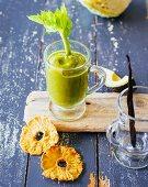 Pineapple and orange smoothie with avocado, celery, savoy cabbage and batavia lettuce