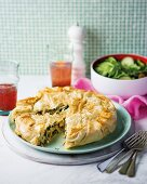 Puff pastry pie with spinach, chicken, feta cheese and eggs (Greece)